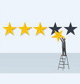 man hangs rating golden star stands on step-ladder vector image