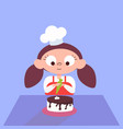 girl decorating chocolate cake in the kitchen vector image