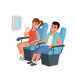 young tourist couple sitting in airplane seats vector image vector image