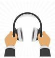 headphones in hands vector image vector image