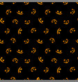 pumpkin faces glowing on black background vector image vector image