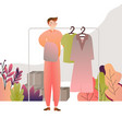 man choosing shirt clothes in a shop store vector image