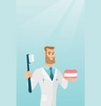 dentist with a dental jaw model and a toothbrush vector image vector image
