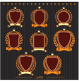 Insignia designs set shields laurel wreaths and ri vector image