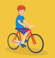happy young boy riding a bicycle vector image