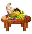 horn of plenty with vegetables and fruits on round vector image vector image