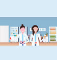 couple female scientists working in hospital vector image vector image