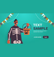 man in skeleton costume holding bucket with vector image vector image