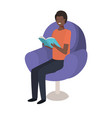 young black man reading book in the sofa vector image vector image