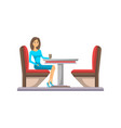 young woman sitting at table in cafe icon vector image