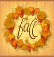 wreath of autumn grape leaves on a dark wood vector image