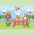 family picnic together in the table and basket vector image