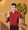 young man holding a bunch of ripe grapes just vector image vector image