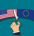 hand with scissors cuts the flag of usa and eu vector image vector image