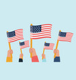 hands holding up american flags vector image vector image