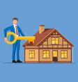 businessman holding big key near house building vector image vector image