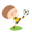 little boy kicking a soccer ball on green field vector image vector image