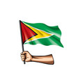 guyana flag and hand on white background vector image vector image
