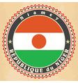 Vintage label cards of Niger flag vector image