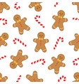 gingerbread man and candy cane pattern vector image