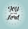 hand lettering joy in the lord with rays on blue vector image vector image
