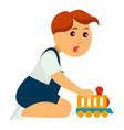little boy that has excited face plays with toy vector image
