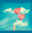 valentine heart-shaped baloons in a blue sky vector image vector image