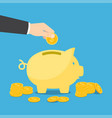 hand puts a coin into the piggy bank vector image