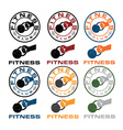 kettlebell in the hand fitness emblems vector image vector image