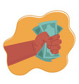 hand holding green money banknotes vector image