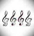 four assorted decorative G clefs vector image