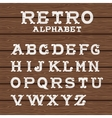 Vintage alphabet on wooden background vector image vector image