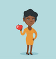 young african-american woman holding an apple vector image vector image