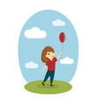 a girl is playing with a balloon on the street vector image vector image