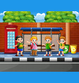 happy school children at the bus stop vector image vector image