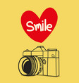 retro photo camera with smile vector image