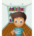 A young boy in front of the bookshelves vector image vector image