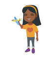 african cheerful girl playing with a toy airplane vector image vector image