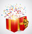Red gift box with confetti vector image vector image
