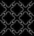 White filigree design on black background floral