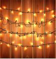 christmas lights realistic garland on wood vector image vector image