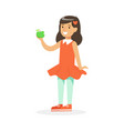 cute smiling girl in red dress eating green apple vector image vector image