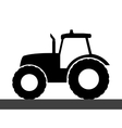 Tractor silhouette on a white background vector image