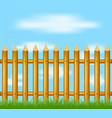 wooden fence standing in grass and blue sky vector image vector image