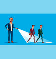 leader businessman illuminates the way of his team vector image vector image