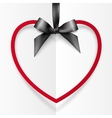 Red heart shape frame hanging on silky black vector image vector image