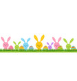 easter bunnies on green grass with colored eggs vector image