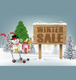 christmas decorative shopping cart on winter hill vector image vector image
