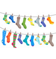 colorful fun socks set hang on the rope vector image