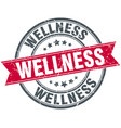 wellness round grunge ribbon stamp vector image vector image